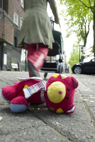 small child losing teddy bear, stuffed animal