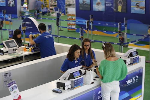 IMAGE DISTRIBUTED FOR VISA - A customer uses the Pulseira Bradesco Visa bracelet to make a purchase at the Copacabana Megastore in Rio de Janeiro Brazil, Thursday, June 30, 2016. (Leo Correa/AP Images for Visa)