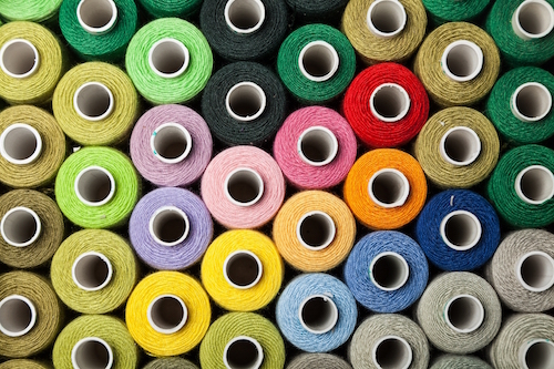 Textile Thread Sewing Textile Industry Spool Multi Colored Rolled Up